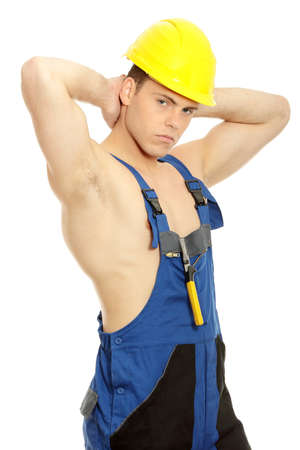 Handsome young topless construction worker, isolated on white background photo