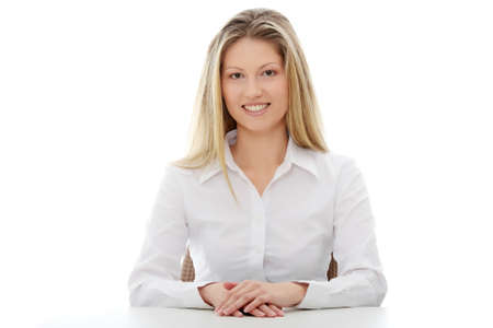 Young beautiful businesswoman behind the desk, isolated  photo
