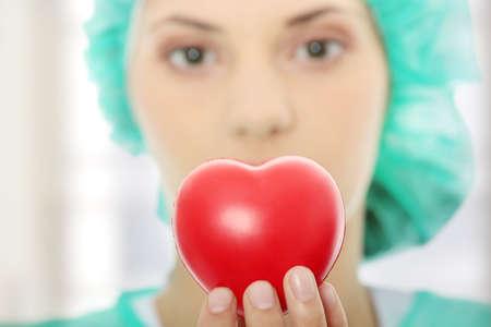 Cardiologist holding heart - focus on heart photo