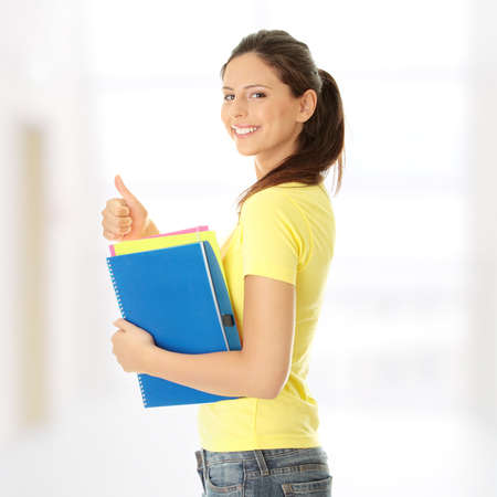 student book: Happy student girl with thumb up