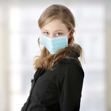 A model wearing a mask to prevent 'Swine Flu' infection.  photo