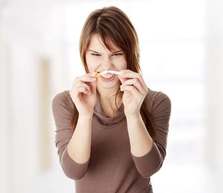quiting smoking: Young caucasian woman quiting smoking Stock Photo