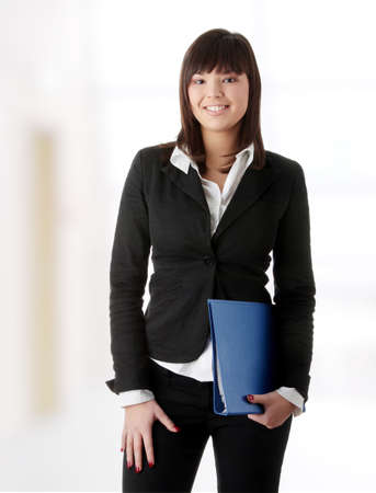 Confident business woman standing wearing elegant clothes photo
