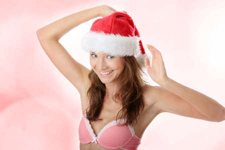Beautiful,slim, fit and sexy Caucasian woman in pink underwear and santa hat photo