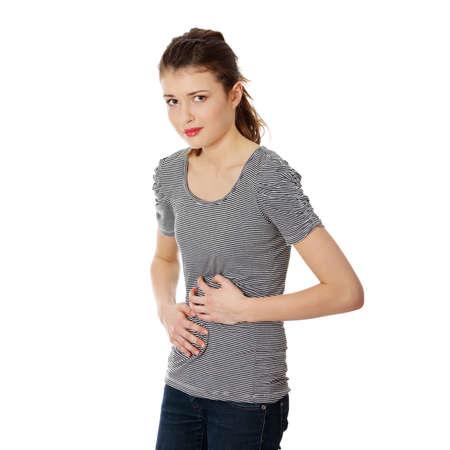 pain in the abdomen: Mujer adolescente con problemas de est�mago, aislados en blanco Foto de archivo
