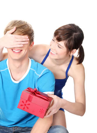 giving gift: Girl give a gift to her boyfriend. Isolated on white background.
