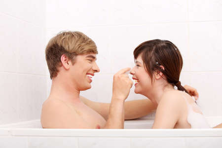 taking bath: Young happy couple taking bath together.