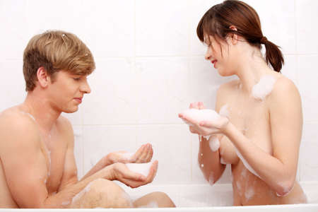 bathing man: Young happy couple taking bath together.