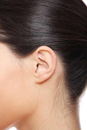 Young caucasian woman ear closeup.  photo