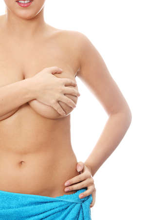 Young caucasian adult woman examining her breast for lumps or signs of breast cancer Stock Photo - 9033404