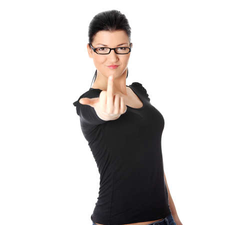 obscene: Young woman with middle finger up, isolated on white background Stock Photo