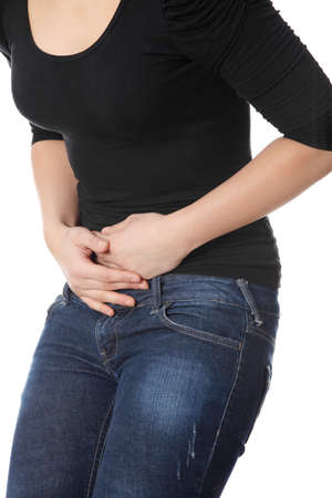 stomach pain: Woman with stomach issues isolated on white background