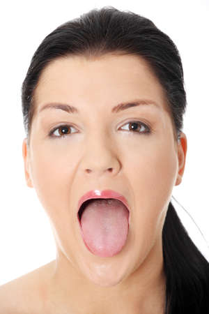 Portrait of beautiful woman who puts tongue out  photo