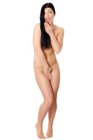 nackt: Junge caucasian Frau gefangen nackt - �berrascht. Isoliert auf weiss.