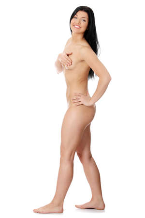 Happy naked woman poses covering itself hands, isolated on a white background