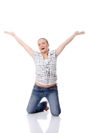 knees up: Young happy woman on knees, with hands up, isolated on white