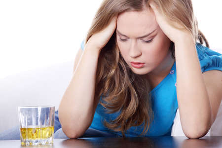 drunk: Yound beautiful woman in depression, drinking alcohol
