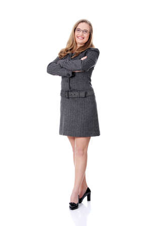 suit skirt: Confident business woman standing wearing elegant clothes - isolated over a white background  Stock Photo