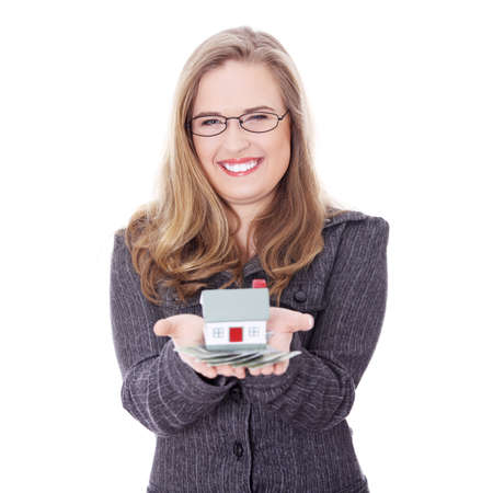 Beautiful young businesswoman holding euros bills and house model over white - real estate loan concept  photo