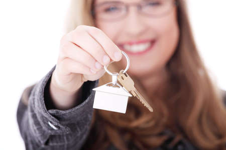 Young businesswoman (real estate agent) with house keys in hand Stockfoto