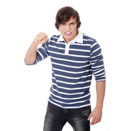Young mad man with fist up Stock Photo - 9035986