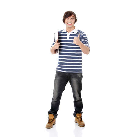 Young happy student man with notebook gesturing OK,isolated on a white background  Stock Photo - 9033182