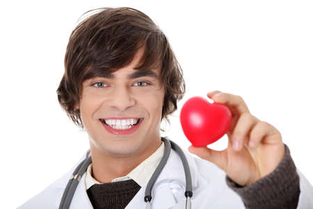 Happy handsome young male doctor holding heart shape toy, isolated on white  photo