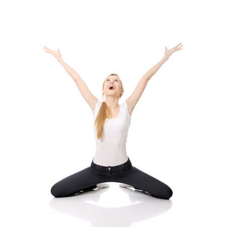 knees up: Young happy caucasian woman on knees , isolated on white background  Stock Photo