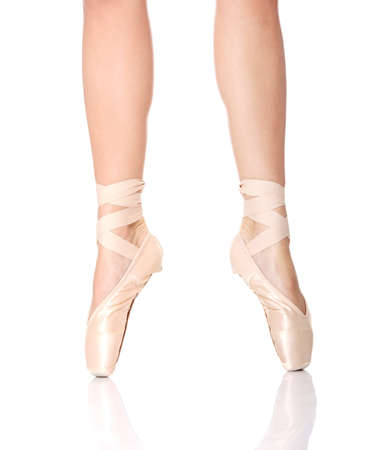 pointe: Detail of ballet dancers feet isolated on white Stock Photo