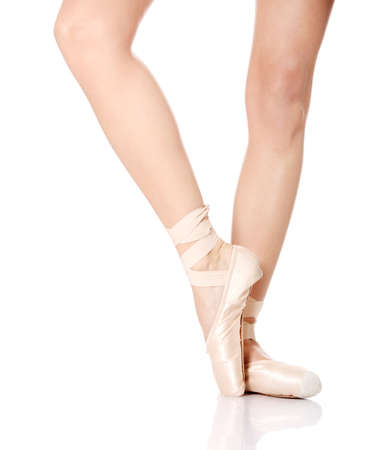 Detail of ballet dancer's feet isolated on white Stock Photo - 9033111