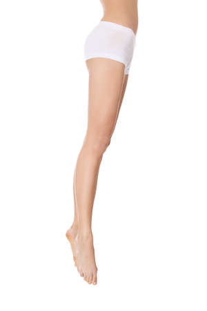 Beautiful woman legs, isolated on white Stock Photo - 9026306