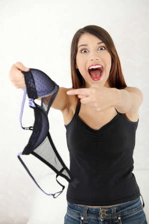 infidelity: Angry woman with bra in hand. Betrayal concept