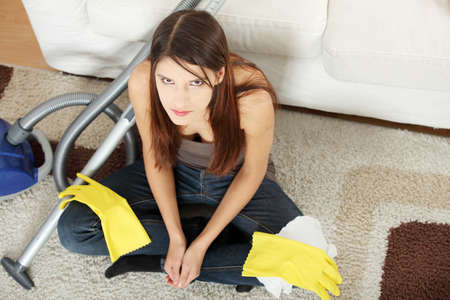 Young woman hates cleaning home. photo