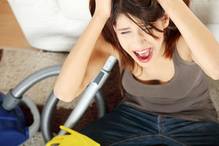 Young woman hates cleaning home. Stock Photo - 9035880