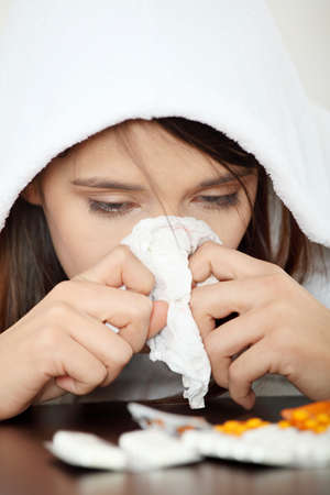 Sick young woman in bathrobe photo