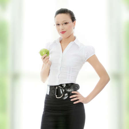 Young businesswoman with green apple in her hand - healthy eating concept  photo