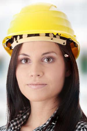 Engineer woman in yellow helmet photo