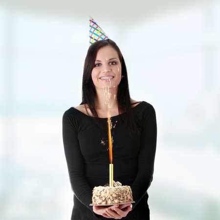 Beautiful young woman with birthday cake Stock Photo - 9033134