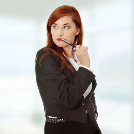 Attractive businesswoman with a pen  photo