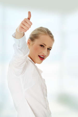 Business women showing thumbs up photo