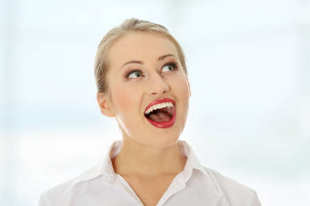 look right: Amazed happy business woman looking right Stock Photo
