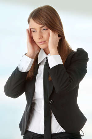 Young woman suffering a headache photo