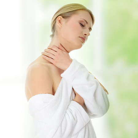 Young beautiful blond teen woman in bathrobe ready for spa Stock Photo - 9033131