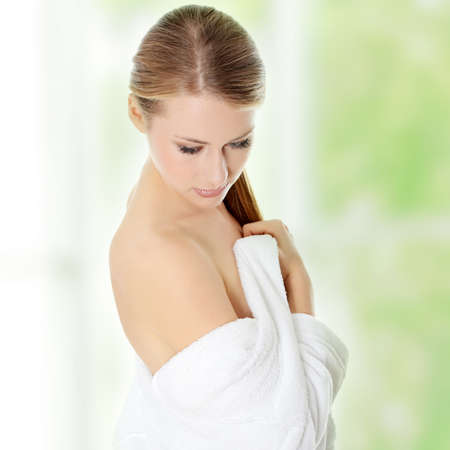woman bathrobe: Young beautiful blond teen woman in bathrobe ready for spa Stock Photo
