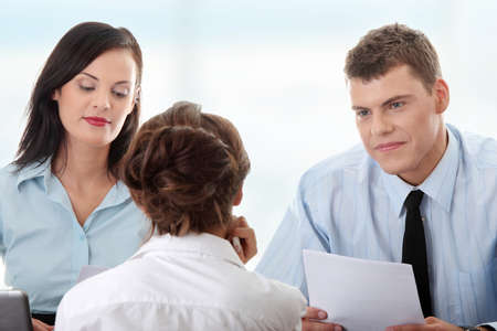 interviewed: Business coaching concept. Young woman being interviewed for a job.