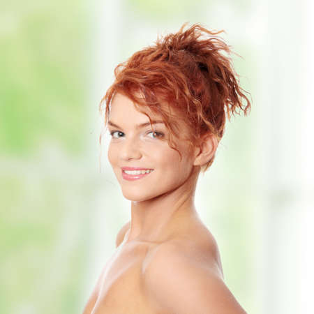 Close-up portrait of sexy caucasian young redhead woman photo