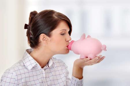 Woman Holding Piggy Bank  photo