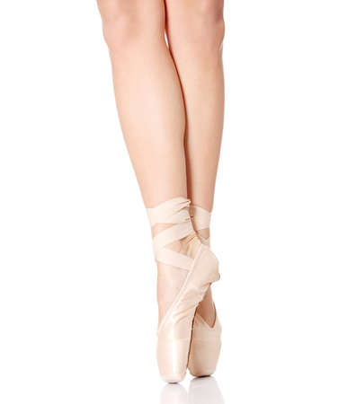 Detail of ballet dancers feet isolated on white photo