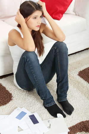 Young woman stressed because of high bills.  photo