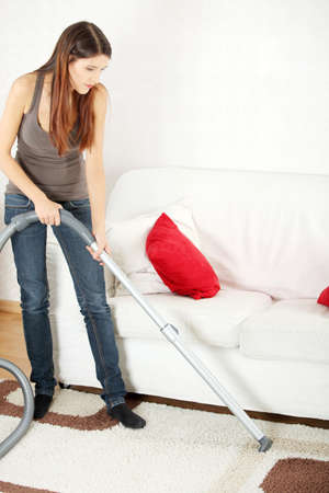 House work,young beautiful woman with vacuum cleanerat home. Housework concept photo